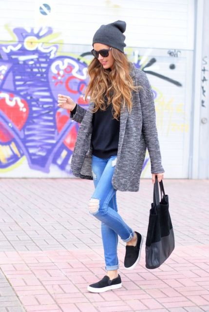 With cardigan, black shirt, skinny jeans and slip on shoes