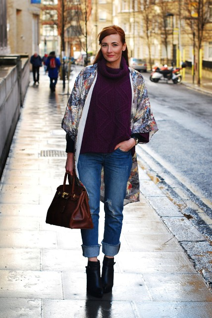 With colorful coat, cuffed jeans and ankle boots