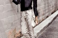 With crop jacket, statement necklace and pumps