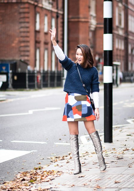 With crop sweater, printed mini skirt and crossbody bag