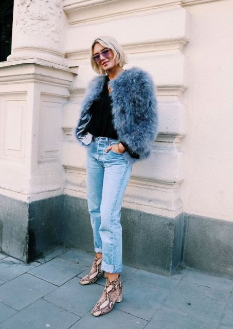 With cuffed jeans, fur short coat and black shirt