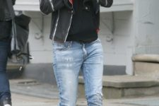 With cuffed jeans, jacket and cap