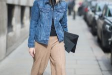 With culottes, denim jacket and clutch