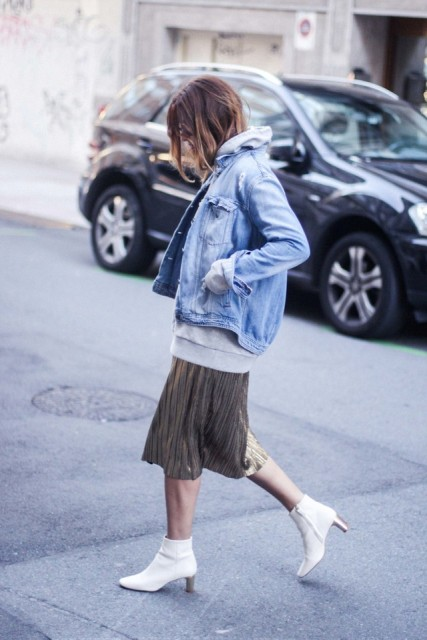 With denim jacket, oversized sweatshirt and metallic pleated skirt