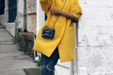 With distressed jeans, black ankle boots and mini bag