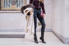 With distressed jeans, jacket and clutch