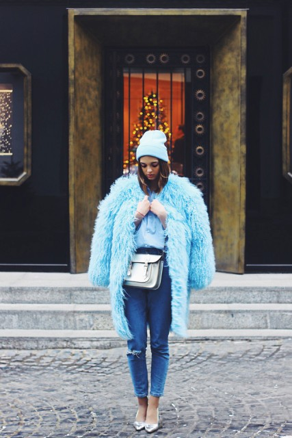 With faux fur knee length coat, crop jeans and heels