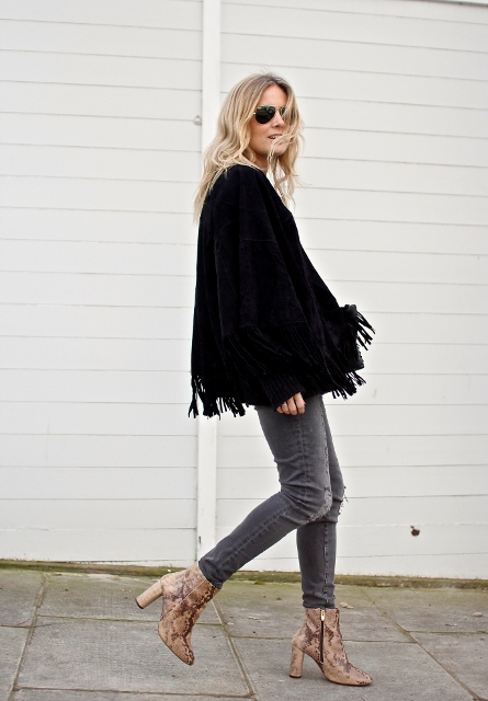 With fringe jacket and distressed jeans