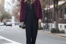 With fur jacket and elegant clutch