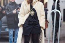 With fur midi coat, black dress and black tights