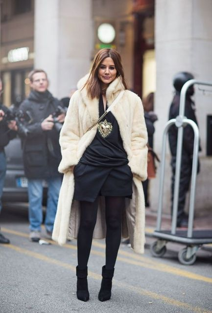 With fur midi coat, black dress and black tights