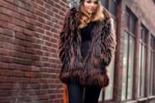 With fur short coat, flat boots and jeans