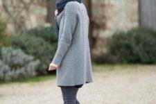 With gray coat, polka dot scarf and gray pants