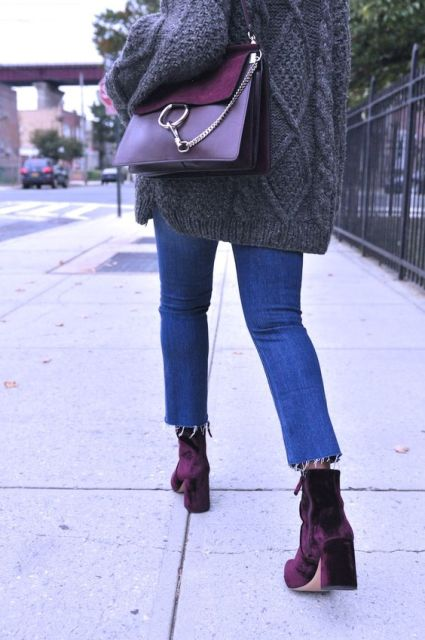 With gray oversized sweater, crop jeans and purple bag