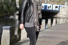 With gray shirt, jeans, leather jacket and printed scarf