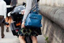 With gray shirt, printed A-line skirt and blue bag