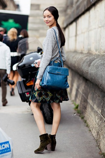 With gray shirt, printed A-line skirt and blue bag