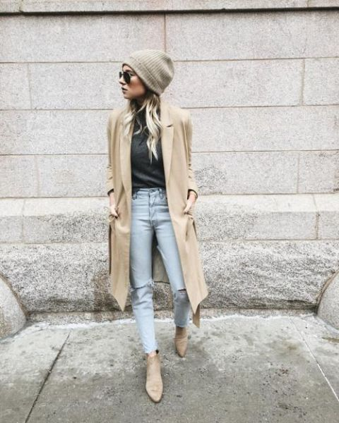 With gray sweater, light color jeans, neutral coat and boots