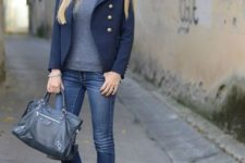 With gray turtleneck, navy blue jacket and skinny jeans
