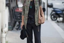 With green army jacket, pumps and light brown tote