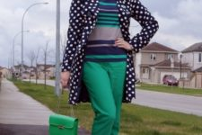 With green pants striped shirt printed shoes and green chain strap bag