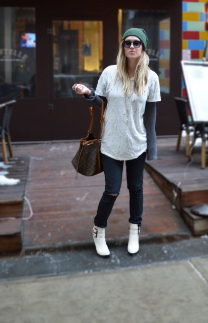 With jeans, gray sweatshirt, white t-shirt and beanie