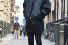 With leather jacket, long sweatshirt and black pants
