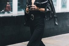 With leather jacket, platform suede boots and clutch