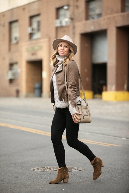 With leather jacket, sweater and black pants
