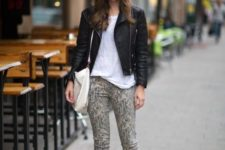 With leather jacket, white shirt and gray boots