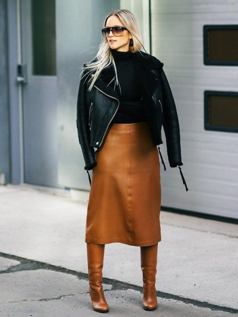 With leather midi skirt, black shirt and high boots