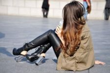 With leather pants and parka