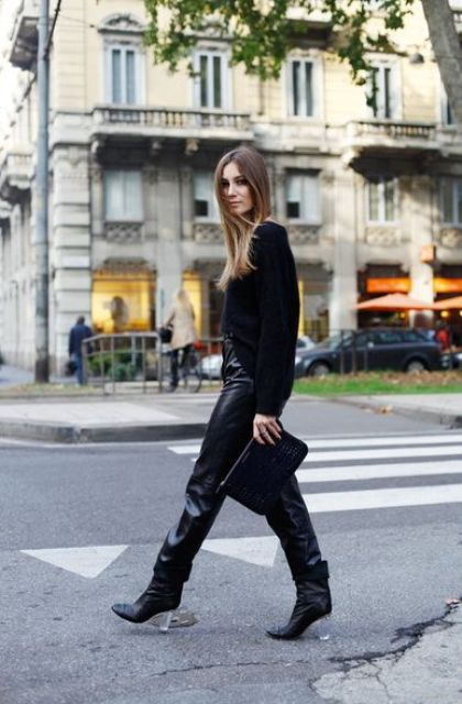 With leather pants, black clutch and jacket