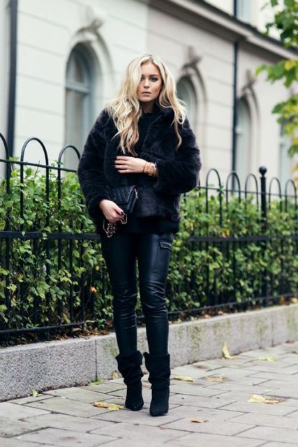 With leather pants, fur jacket and clutch