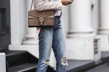 With leather white jacket, distressed jeans and chain strap bag