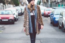 With leopard printed coat distressed jeans and black ankle boots