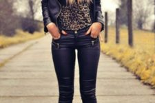 With leopard shirt, leather jacket, skinnies and beanie