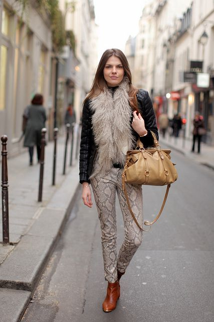 With light brown bag, brown ankle boots and jacket with fur