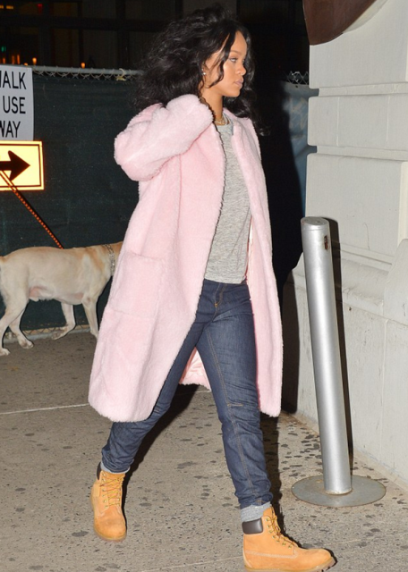 With light pink coat and boyfriend jeans