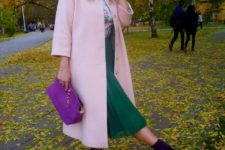 With light pink coat, green skirt and purple bag