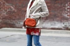 With long shirt, flare jeans and mini bag