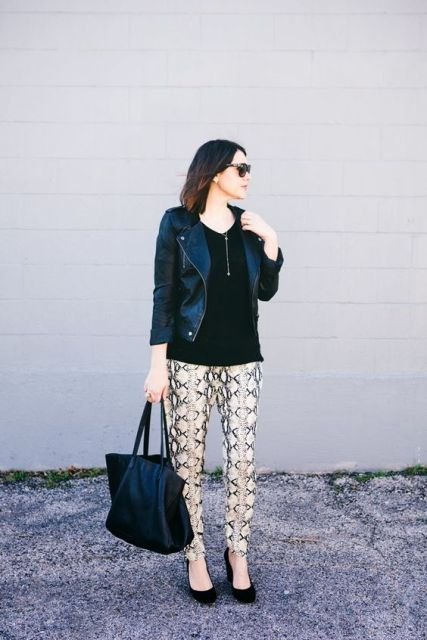With loose black blouse, tote, jacket and pumps