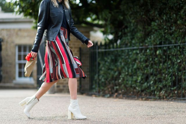 With midi colored skirt and black leather jacket