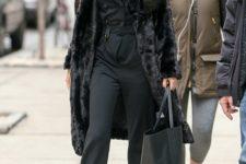 With midi fur coat, big bag and heels
