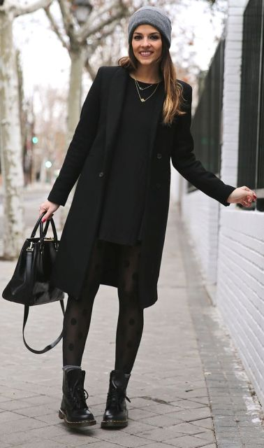 With mini black dress, printed tights, mid calf boots and black knee length coat