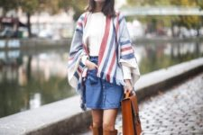 With mini denim skirt, big leather bag and white shirt