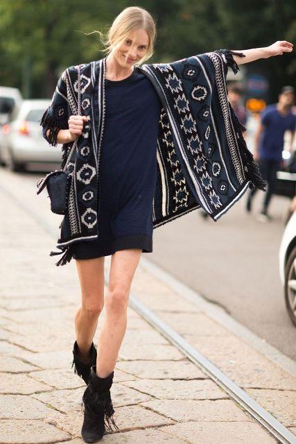 With navy blue mini dress and mini bag