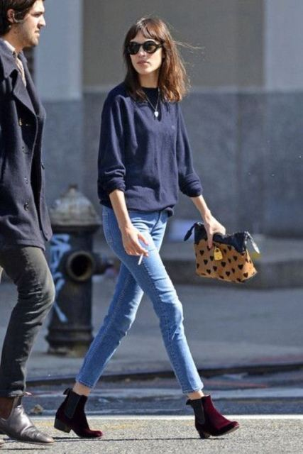 With navy blue shirt, skinny pants and printed clutch