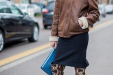 With navy blue skirt, leather jacket and clutch