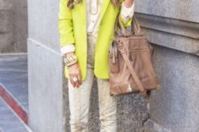 With neon blazer and camel bag